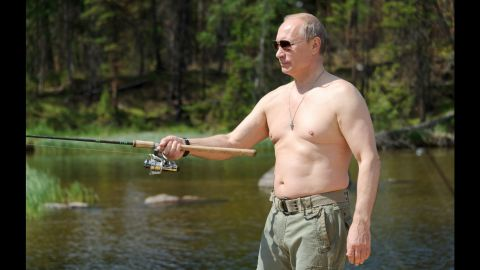 Putin fishes in Russia's Tuva region during a vacation in July 2013. For years, Putin has cultivated a populist image in the Russian media.