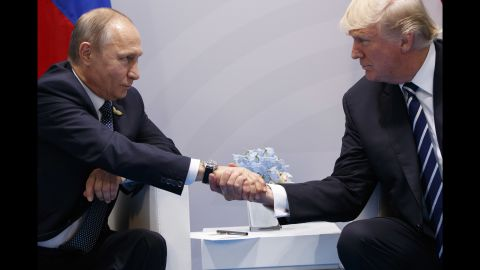 """Putin shakes hands with US President Donald Trump <a href=""""http://www.cnn.com/2017/07/07/politics/trump-putin-meeting/index.html"""" target=""""_blank"""">as they meet on the sidelines</a> of the G20 summit in Germany in July 2017. They talked for more than two hours, discussing interference in US elections and ending with an agreement on curbing violence in Syria."""
