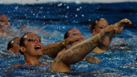 Members of the Hungarian synchronized swimming team perform during halftime of the Water Polo European Championships match between Hungary and Spain.