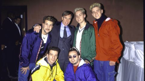 (L-R, top row) Singers Joey Fatone, Lance Bass and Justin Timberlake w. (L & R, bottom row) J. C. Chasez and Chris Kirkpatrick of musical group 'N Sync w. fashion designer Toomy Hilfiger (2L, top row) at Roseland.  (Photo by Dave Allocca/DMI/The LIFE Picture Collection/Getty Images)