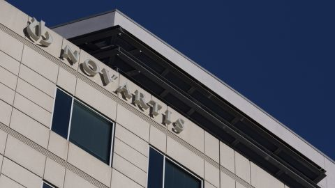 A sign for Novartis International pharmaceutical company is seen on a building in Cambridge, Massachusetts, on March 18, 2017.