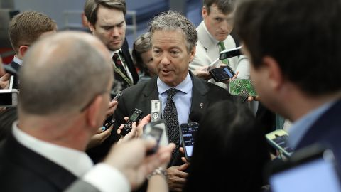 Sen. Rand Paul (R-KY) speaks with reporters while walking to a vote on the Senate floor at the U.S. Capitol July 12, 2017 in Washington, D.C. (Win McNamee/Getty Images)