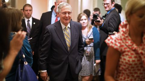 WASHINGTON, DC - JULY 13:  Senate Majority Leader Mitch McConnell (R-KY) smiles as he heads for the Senate Floor following a meeting where he shared a new version of a healthcare bill with fellow GOP senators at the U.S. Capitol July 13, 2017 in Washington, DC. The latest version of the proposed bill aims to repeal and replace the Affordable Care Act, also knows as Obamacare.  (Photo by Chip Somodevilla/Getty Images)