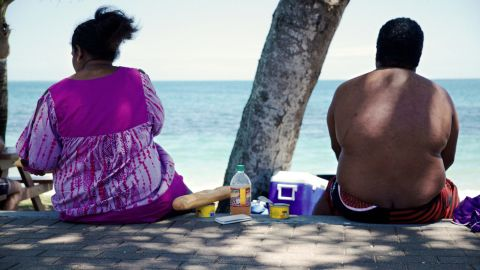 TO GO WITH AFP STORY BY CLAUDINE WERY People sit along the beach looking out at sea in Noumea on December 1, 2014. Obesity and diabetes are affecting citizens throughout the South Pacific islands, proportionately among the highest in the world, due to the change in eating habits and lifestyles as well as a genetic predisposition. AFP PHOTO/THEO ROUBY        (Photo credit should read THEO ROUBY/AFP/Getty Images)