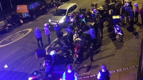 Twitter post captions: Police and ambulances on Hackney/Queensbridge Road, possible acid/petrol attack. Lots of @UberEATS @Deliveroo drivers rallied round