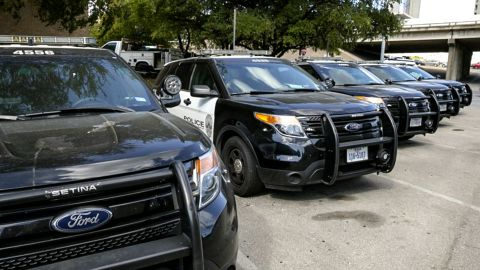 Austin Police Ford utility vehicles are parked on East 8th Street outside APD Headquarters on Tuesday July 11, 2017.