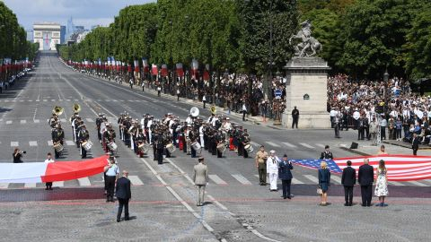 (RtoL) US First Lady Melania Trump, US President Donald Trump, French President Emmanuel Macron and his wife Brigitte Macron, walk towards the US national flag held by soldiers, as a French joint-army brass band performs, at the end of the annual Bastille Day military parade on the Champs-Elysees avenue in Paris on July 14, 2017.  The parade on Paris's Champs-Elysees will commemorate the centenary of the US entering WWI and will feature horses, helicopters, planes and troops. / AFP PHOTO / ALAIN JOCARD        (Photo credit should read ALAIN JOCARD/AFP/Getty Images)
