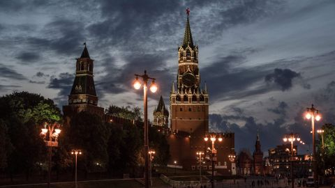 The sun sets behind the Kremlin at the Red Square in Moscow on June 8, 2017.