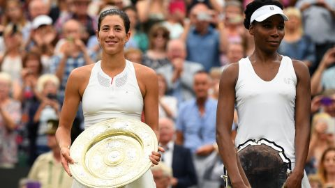 LONDON, ENGLAND - JULY 15:  Garbine Muguruza of Spain celebrates victory with the trophy alongside runner up Venus Williams of The United States after the Ladies Singles final on day twelve of the Wimbledon Lawn Tennis Championships at the All England Lawn Tennis and Croquet Club at Wimbledon on July 15, 2017 in London, England.  (Photo by David Ramos/Getty Images)