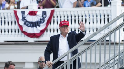 President Donald Trump waves to well-wishers as he arrives at the US Women's Open at Trump National Golf Course in New Jersey. (SAUL LOEB/AFP/Getty Images)