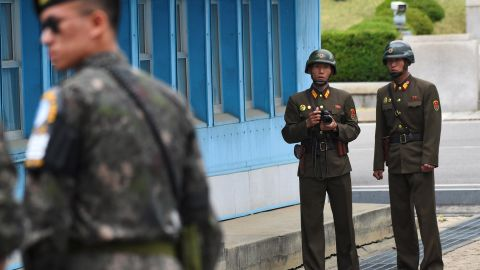 North Korean soldiers (R) look at the South side while US Vice President Mike Pence (not pictured) visits the truce village of Panmunjom in the Demilitarized Zone (DMZ) on the border between North and South Korea on April 17, 2017. Pence arrived at the gateway to the Demilitarised Zone dividing the two Koreas, in a show of US resolve a day after North Korea failed in its attempt to test another missile. / AFP PHOTO / JUNG Yeon-Je        (Photo credit should read JUNG YEON-JE/AFP/Getty Images)
