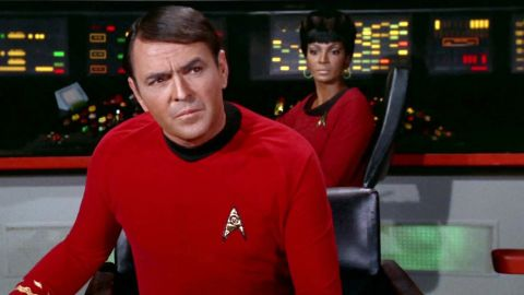 """LOS ANGELES - JANUARY 12: James Doohan as Montgomery """"Scotty"""" Scott on the bridge with Nichelle Nichols as Uhura in the STAR TREK episode, """"A Piece of the Action.""""  Original air date, January 12, 1968, season 2, episode 17.  Image is a screen grab.  (Photo by CBS via Getty Images)"""