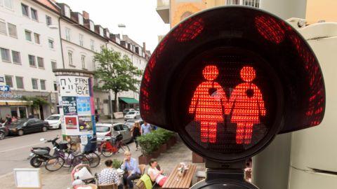 A pedestrian crossing signal showing a female couple in July 2015 in Munich.