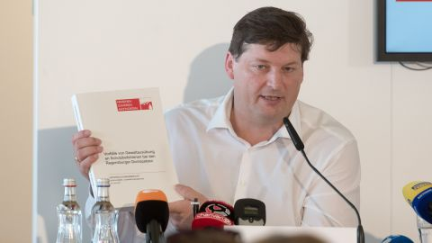 Lawyer Ulrich Weber presents his report during a press conference on July 18, in Regensburg.