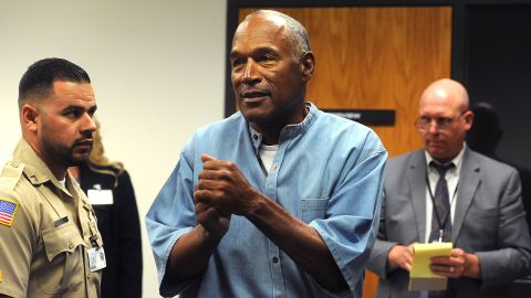 LOVELOCK, NV - JULY 20:  O.J. Simpson (C) reacts after learning he was granted parole at Lovelock Correctional Center July 20, 2017 in Lovelock, Nevada. Simpson is serving a nine to 33 year prison term for a 2007 armed robbery and kidnapping conviction. (Photo by Jason Bean-Pool/Getty Images)