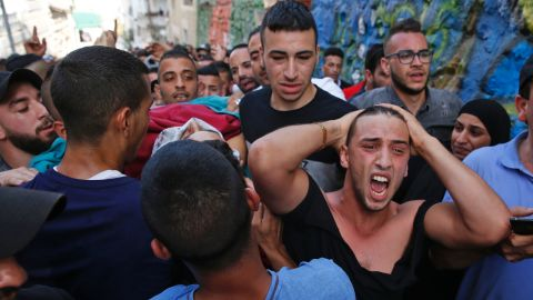Palestinians on Friday carry the body of a man who was killed during clashes with Israeli forces.