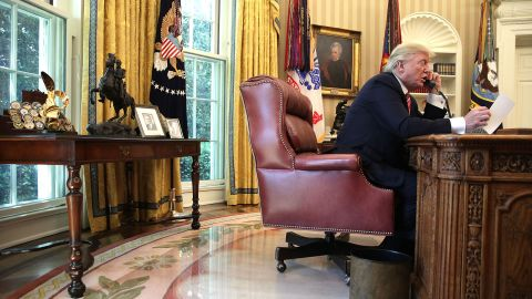 U.S. President Donald Trump speaks on the phone with Irish Prime Minister Leo Varadkar on the phone in the Oval Office of the White House June 27, 2017 in Washington, DC. President Trump congratulated Prime Minister Varadkar to become the new leader of Ireland.