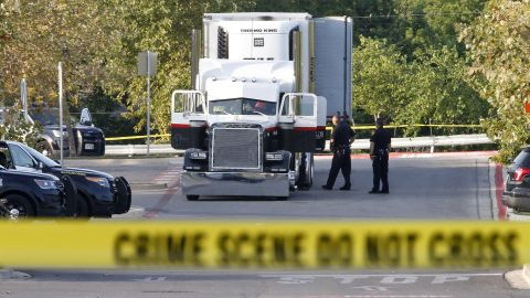 Law enforcement at the scene, where people were discovered inside a tractor trailer in a Walmart parking lot at IH35 South and Palo Alto Road in San Antonio, Texas on Sunday, July 23, 2017. Reports say that 8 were dead and several were in critical condition.