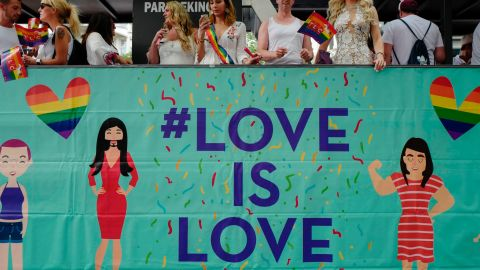 """Participants ride in a """"Love is Love"""" float during Berlin's annual Christopher Street Day gay pride parade in July 2017."""