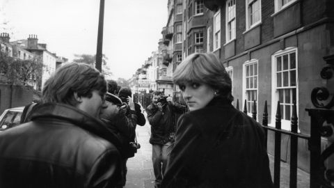 Diana is surrounded by photographers shortly before it was announced that she was engaged to Prince Charles.