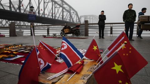 Chinese vendors sell North Korea and China flags on the boardwalk next to the Yalu river in the border city of Dandong in China's Liaoning province.