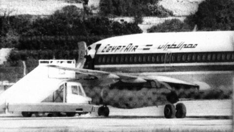 One of the three hijackers of EgyptAir flight 648 appears at the open doorway at Luqa airport in Valletta, Malta, Nov. 24, 1985.  The jet bound for Athens was diverted to Malta on Nov. 23 by the Abu Nidal Group.  (AP Photo/Pardi)