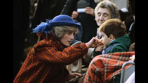 Diana greets a child while visiting Wrexham, Wales, in November 1982.