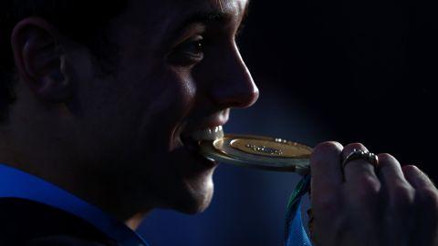 Tom Daley of Great Britain celebrates his gold medal in the men's 10M platform Saturday.