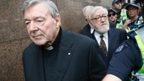 MELBOURNE, AUSTRALIA - JULY 26:  Cardinal George Pell and his barrister Robert Richter leave the Melbourne Magistrates Court with a heavy police guard in Melbourne on July 26, 2017 in Melbourne, Australia. Cardinal Pell was charged on summons by Victoria Police on 29 June over multiple allegations of sexual assault. Cardinal Pell is Australia's highest ranking Catholic and the third most senior Catholic at the Vatican, where he was responsible for the church's finances. Cardinal Pell has leave from his Vatican position while he defends the charges.  (Photo by Darrian Traynor/Getty Images)