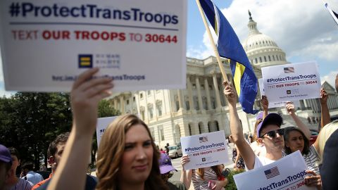Gay rights supporters hold signs during a press conference at the U.S. Capitol condemning the new ban on transgendered servicemembers on July 26, 2017 in Washington, DC.  U.S. Rep. Joe Kennedy held a news conference with members of the House leadership and the LGBT Equality Caucus to denounce the decision by U.S. President Donald Trump to ban transgendered servicemembers.