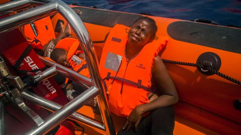 """A woman cries <a href=""""http://www.cnn.com/2017/07/26/europe/migrant-crisis-mediterranean/index.html"""" target=""""_blank"""">after being rescued</a> in the Mediterranean Sea about 15 miles north of Sabratha, Libya, on July 25, 2017. More than 6,600 migrants and refugees entered Europe by sea in January 2018, <a href=""""https://www.iom.int/news/90-migrants-reportedly-drown-bodies-wash-libyan-shores"""" target=""""_blank"""" target=""""_blank"""">according to the UN migration agency</a>, and more than  240 people died on the Mediterranean Sea during that month."""
