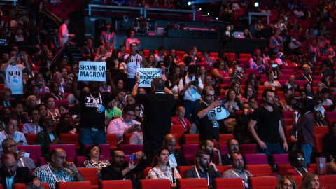 Political activists question French President Emmanuel Macron's failure to open this week's AIDS conference in Paris.