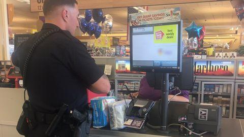Officer Bennett Johns making his charitable purchase.