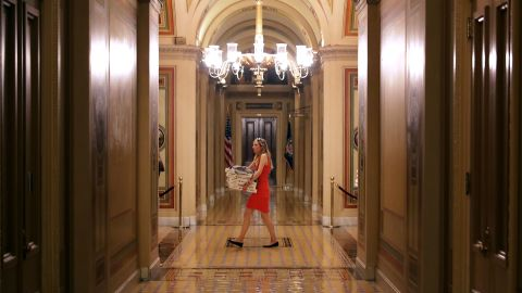 A Senate staff member carrys an armload of pizzas into the U.S. Capitol in anticipation of all-night voting July 27, 2017 in Washington, DC. Senate Republicans are working to pass a stripped-down, or 'Skinny Repeal,' version of Obamacare reform that might include repealing individual and employer mandates and tax on medical devices.