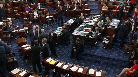 """Senators talk on the floor of the US Senate before the vote on the """"skinny repeal"""" on July 28."""