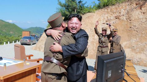 """TOPSHOT - This picture taken on July 4, 2017 and released by North Korea's official Korean Central News Agency (KCNA) on July 5, 2017 shows North Korean leader Kim Jong-Un (C) celebrating the successful test-fire of the intercontinental ballistic missile Hwasong-14 at an undisclosed location. South Korea and the United States fired off missiles on July 5 simulating a precision strike against North Korea's leadership, in response to a landmark ICBM test described by Kim Jong-Un as a gift to """"American bastards"""". / AFP PHOTO / KCNA VIA KNS / STR / South Korea OUT / REPUBLIC OF KOREA OUT   ---EDITORS NOTE--- RESTRICTED TO EDITORIAL USE - MANDATORY CREDIT """"AFP PHOTO/KCNA VIA KNS"""" - NO MARKETING NO ADVERTISING CAMPAIGNS - DISTRIBUTED AS A SERVICE TO CLIENTS THIS PICTURE WAS MADE AVAILABLE BY A THIRD PARTY. AFP CAN NOT INDEPENDENTLY VERIFY THE AUTHENTICITY, LOCATION, DATE AND CONTENT OF THIS IMAGE. THIS PHOTO IS DISTRIBUTED EXACTLY AS RECEIVED BY AFP.    /         (Photo credit should read STR/AFP/Getty Images)"""