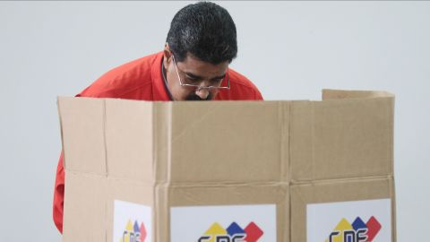 """Handout photo released by the Venezuelan Presidency shows president Nicolas Maduro casting his vote in Caracas on July 30, 2017. Polls opened in Venezuela on Sunday for the election of a new, all-powerful """"Constituent Assembly"""" that President Nicolas Maduro promised would end his country's political and economic crisis by rewriting the constitution. The vote has been fiercely opposed by months of deadly street protests and criticized internationally. Venezuela's opposition says it is a bid for the beleaguered Maduro to cling to power by getting around the parliament controlled by its lawmakers."""
