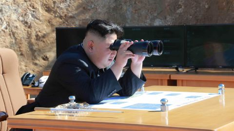 """This picture taken and released on July 4, 2017 by North Korea's official Korean Central News Agency (KCNA) shows North Korean leader Kim Jong-Un inspecting the test-fire of intercontinental ballistic missile Hwasong-14 at an undisclosed location. North Korea declared on July 4 it had successfully tested its first intercontinental ballistic missile -- a watershed moment in its push to develop a nuclear weapon capable of hitting the mainland United States. / AFP PHOTO / KCNA VIA KNS / STR / South Korea OUT / REPUBLIC OF KOREA OUT   ---EDITORS NOTE--- RESTRICTED TO EDITORIAL USE - MANDATORY CREDIT """"AFP PHOTO/KCNA VIA KNS"""" - NO MARKETING NO ADVERTISING CAMPAIGNS - DISTRIBUTED AS A SERVICE TO CLIENTS THIS PICTURE WAS MADE AVAILABLE BY A THIRD PARTY. AFP CAN NOT INDEPENDENTLY VERIFY THE AUTHENTICITY, LOCATION, DATE AND CONTENT OF THIS IMAGE. THIS PHOTO IS DISTRIBUTED EXACTLY AS RECEIVED BY AFP.   /         (Photo credit should read STR/AFP/Getty Images)"""