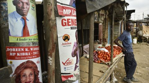 A vendor waits for customers at his tomato stall beside electoral posters in the Kibera slum in Nairobi, Kenya, on Friday, July 21, 2017. Kenya, East Africas biggest economy, has faced questions about the credibility of its past two elections, with a dispute over the outcome of a presidential vote in December 2007 triggering two months of ethnic violence that left at least 1,100 people dead. Photographer: Riccardo Gangale/Bloomberg via Getty Images