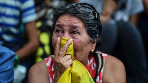 """A woman in Caracas attends a vigil Monday, July 31, for anti-government activists who have died in the country's recent unrest. <a href=""""http://www.cnn.com/2017/08/01/americas/venezuela-election-unrest/index.html"""">More than 120 people have been killed in Venezuela </a>since early April, according to the attorney general's office."""
