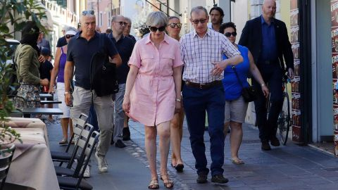 May's Cabinet has been fighting over Brexit as she vacations in Switzerland with husband Philip.