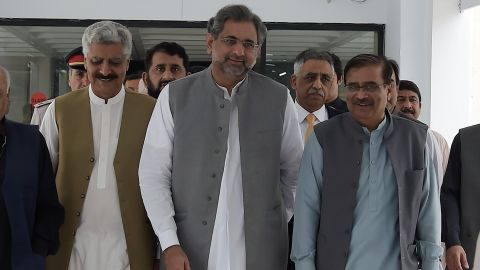 """Prime Minister Shahid Khaqan Abbasi, center, told lawmakers that moving the tribal areas under the control of Khyber Pakhtunkhwa province reflects a """"much-needed consensus."""""""