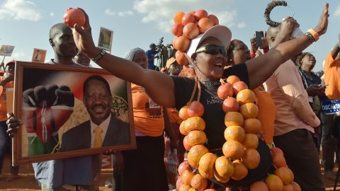 Supporters of the National Super Alliance (NASA) party listen to the oppostion leader and presidential candidate Raila Odinga during a campaign rally in Nairobi on July 18, 2017.  / AFP PHOTO / /SIMON MAINA / SIMON MAINA        (Photo credit should read SIMON MAINA/AFP/Getty Images)