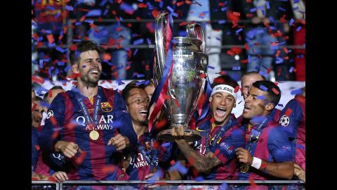 Neymar lifts the trophy after Barcelona won the Champions League in June 2015. It completed a historic treble for the Spanish club, which also won the league and the Copa del Rey that season.
