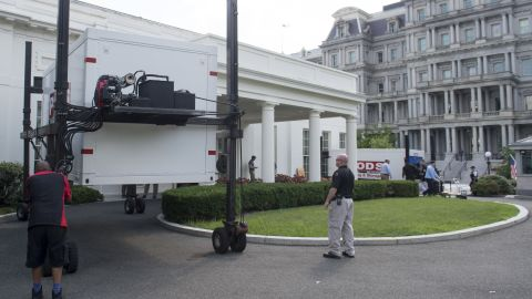 Storage containers are delivered outside the West Wing of the White House in Washington, DC, August 4, 2017, as workers prepare to complete maintenance and updates to the West Wing.