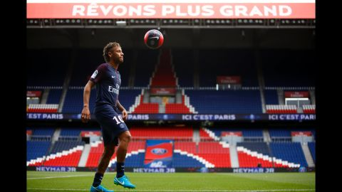 Neymar juggles a ball Friday, August 4, after he was unveiled to the media as Paris Saint-Germain's newest signing. His transfer fee was more than double the previous world record.