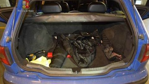 A police photo shows a large bag in the back of a car.