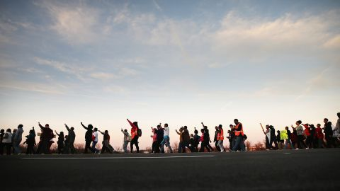 FERGUSON, MO - NOVEMBER 29:  Members of the NAACP and their supporters start out for the first day of Journey for Justice, seven-day 120-mile march from the Canfield Green apartments where Michael Brown was killed to the Governor's mansion in Jefferson City, Missouri on November 29, 2014 in Ferguson, Missouri. The Ferguson area has been struggling to return to normal since the August 9 shooting of Brown, an 18-year-old black man, who was killed by Darren Wilson, a white Ferguson police officer. When the grand jury announced on November 24, that Wilson would not face charges in the shooting rioting and looting broke out throughout the area leaving several businesses burned to the ground.  (Photo by Scott Olson/Getty Images)
