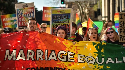 Supporters of same sex marriage carry banners and shout slogans as they march in Sydney on August 6.