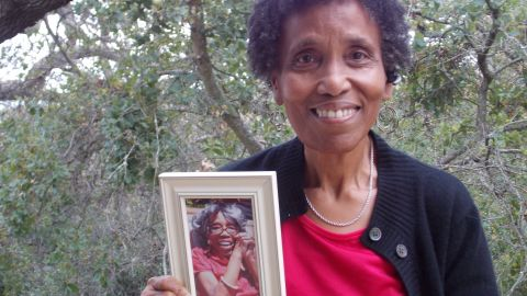 Andrea Gourdine holds a photo of her mother, Gladys Brown, who donated her brain to the University of California-Davis for research.